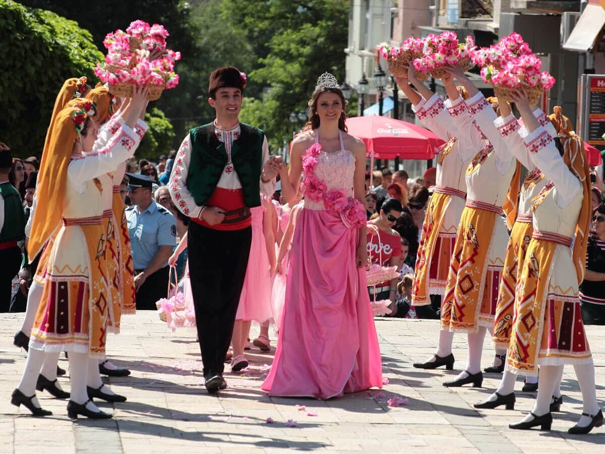 Rose Queen and her prince walking around the centre of Karlovo, Bulgaria