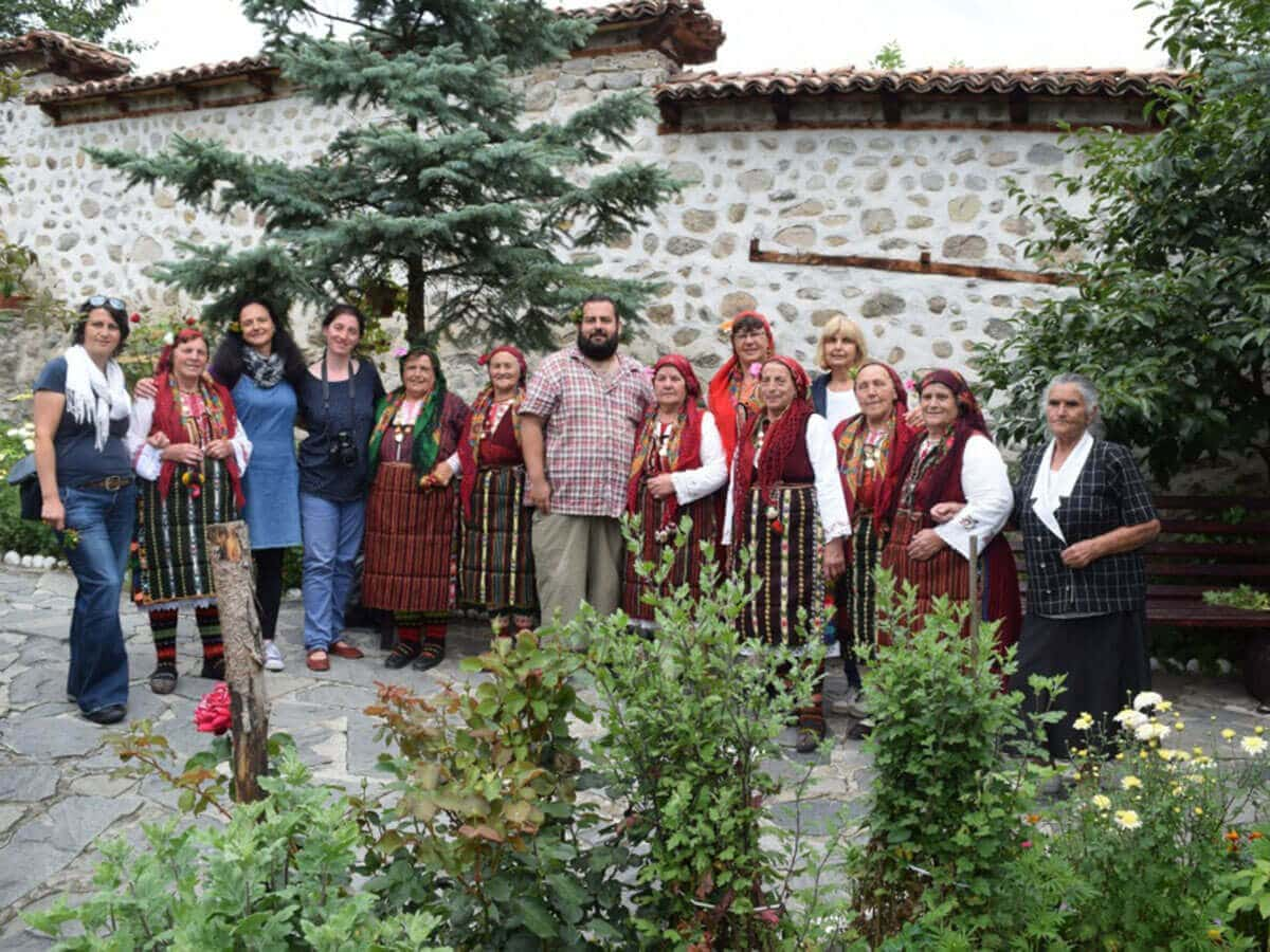 The Dobarsko's Grannies taking a photo with foreigners in the backyard of St. Theodore Tyron and St. Theodore Stratilates church in Dobarsko