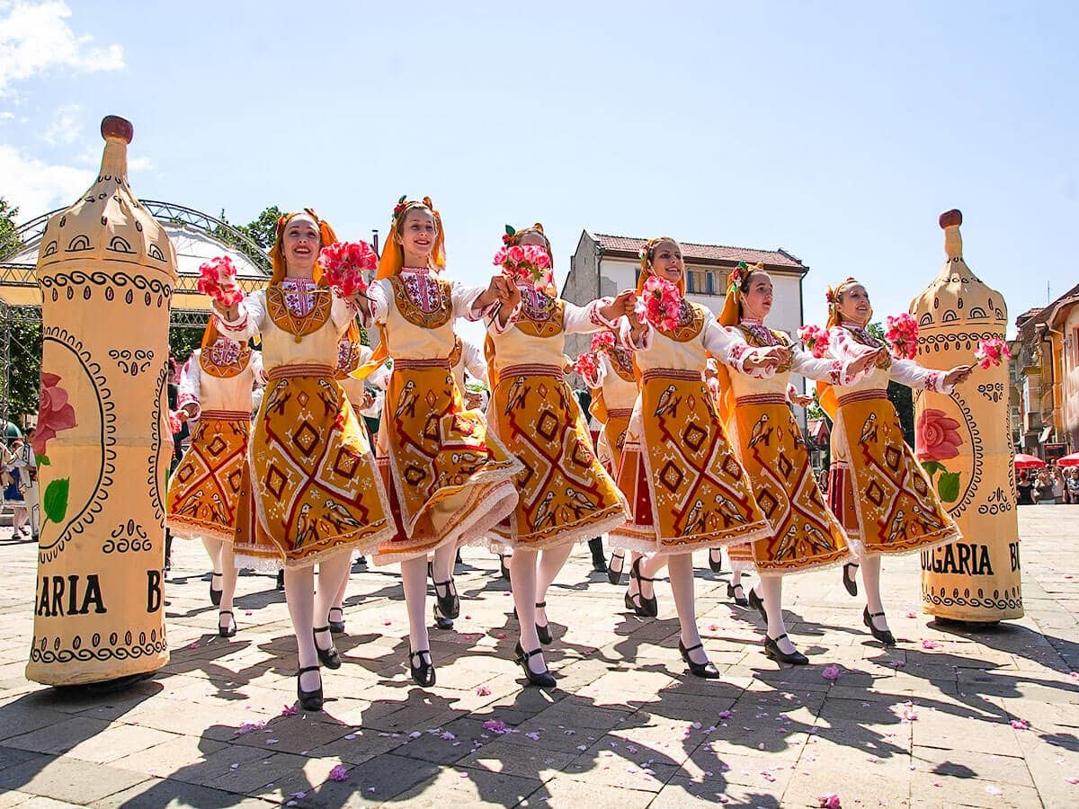 Bulgarian folklore group of women dancing during the Rose Festival in the city centre of Karlovo