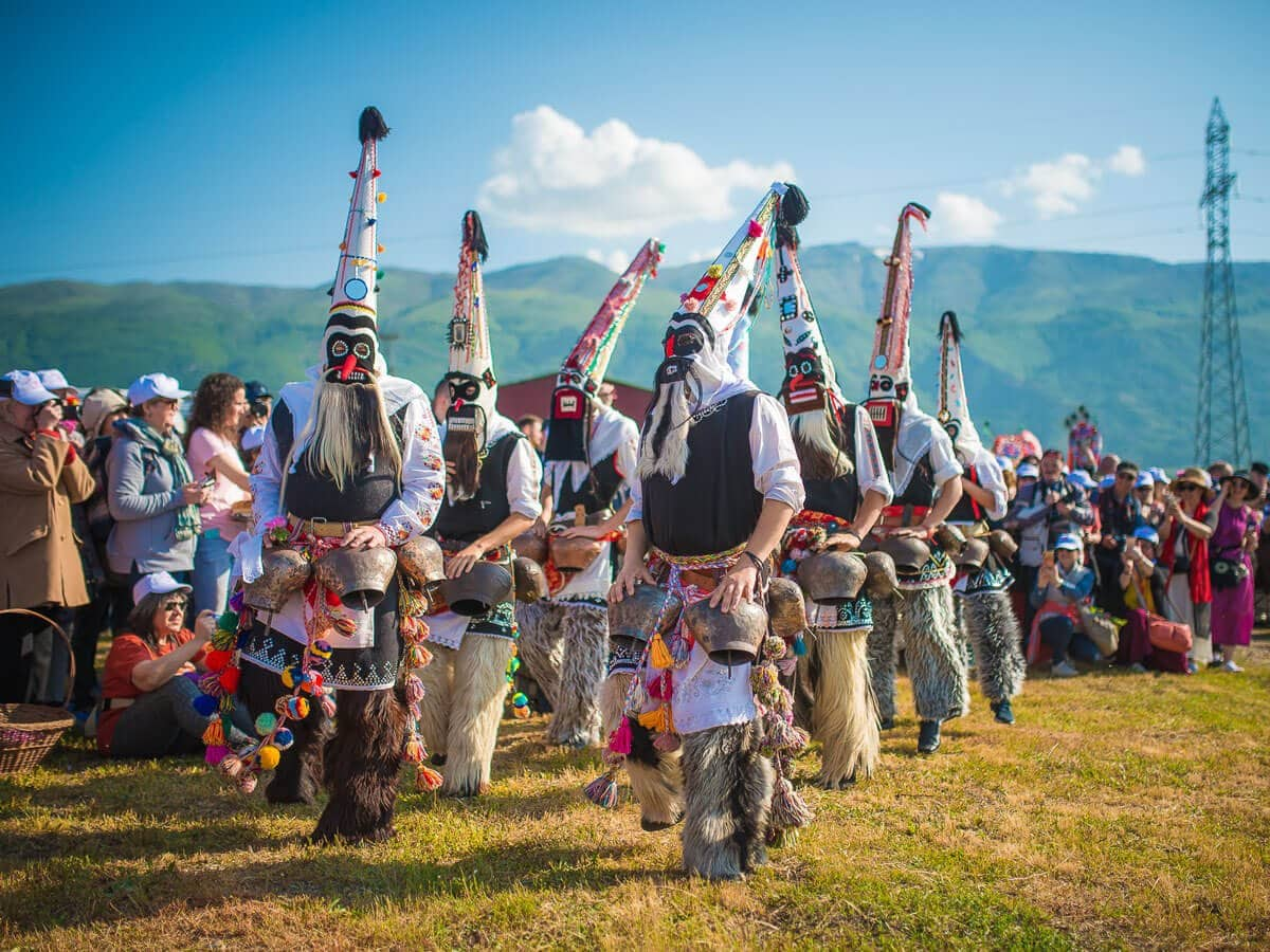 Bulgarian men dressed like kukeri dancing during the Rose Festival in Karlovo, Bulgaria