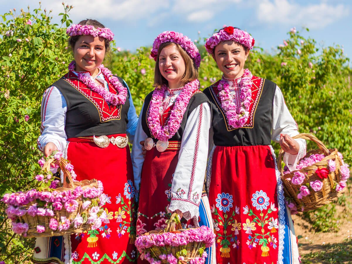 Bulgarian girls dressed in traditional Bulgarian folklore costumes posing during the Rose Festival