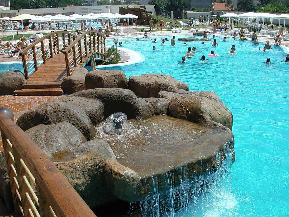 Outdoor swimming pool with mineral water full of people in Hisarya, Bulgaria