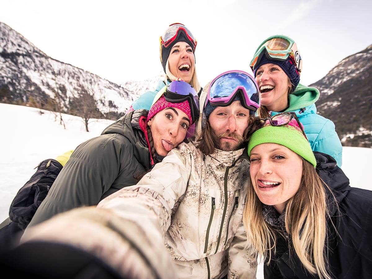 Happy group of first-time skiers having fun on winter vacation