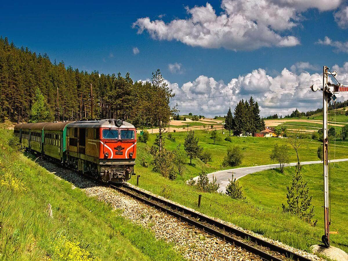 Red passenger train operating from Sofia to Plovdiv