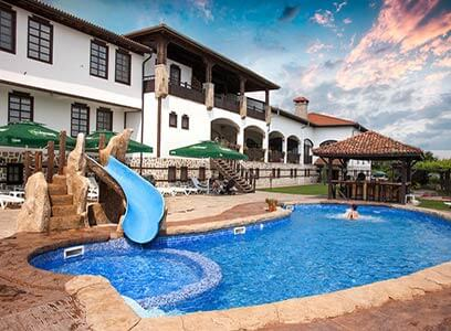 Woman swimming in the outdoor pool of Wine & Spa Complex Starosel. It is one of the best accommodations in Bulgaria