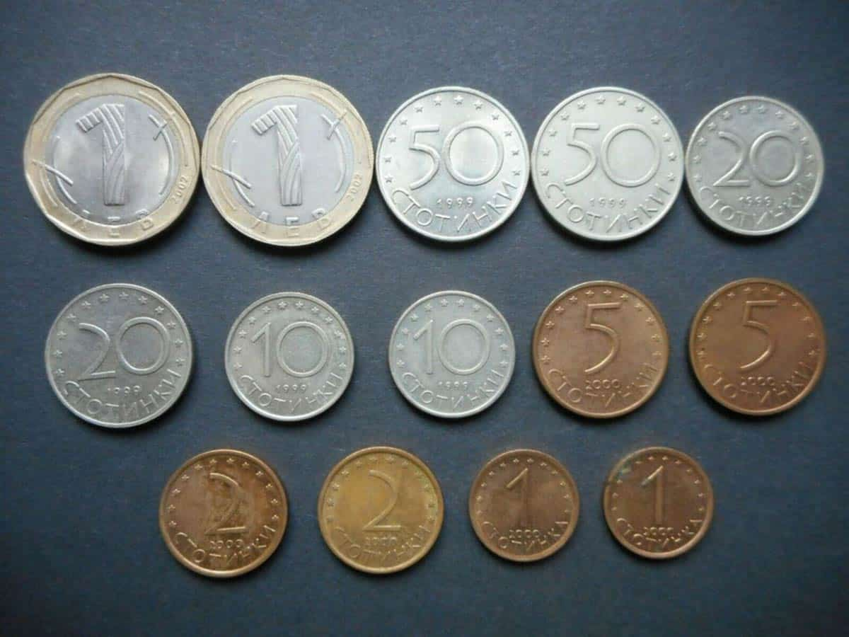 An image on white background with Bulgarian stotinki: 1,2,5,10,20,50 and 1 Bulgarian lev