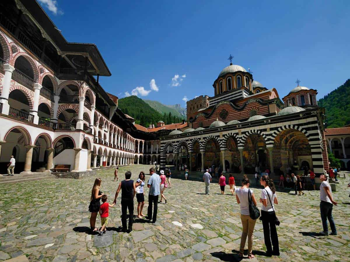 Group of tourists exploring the Rila Monastery in a custom holidays in Bulgaria