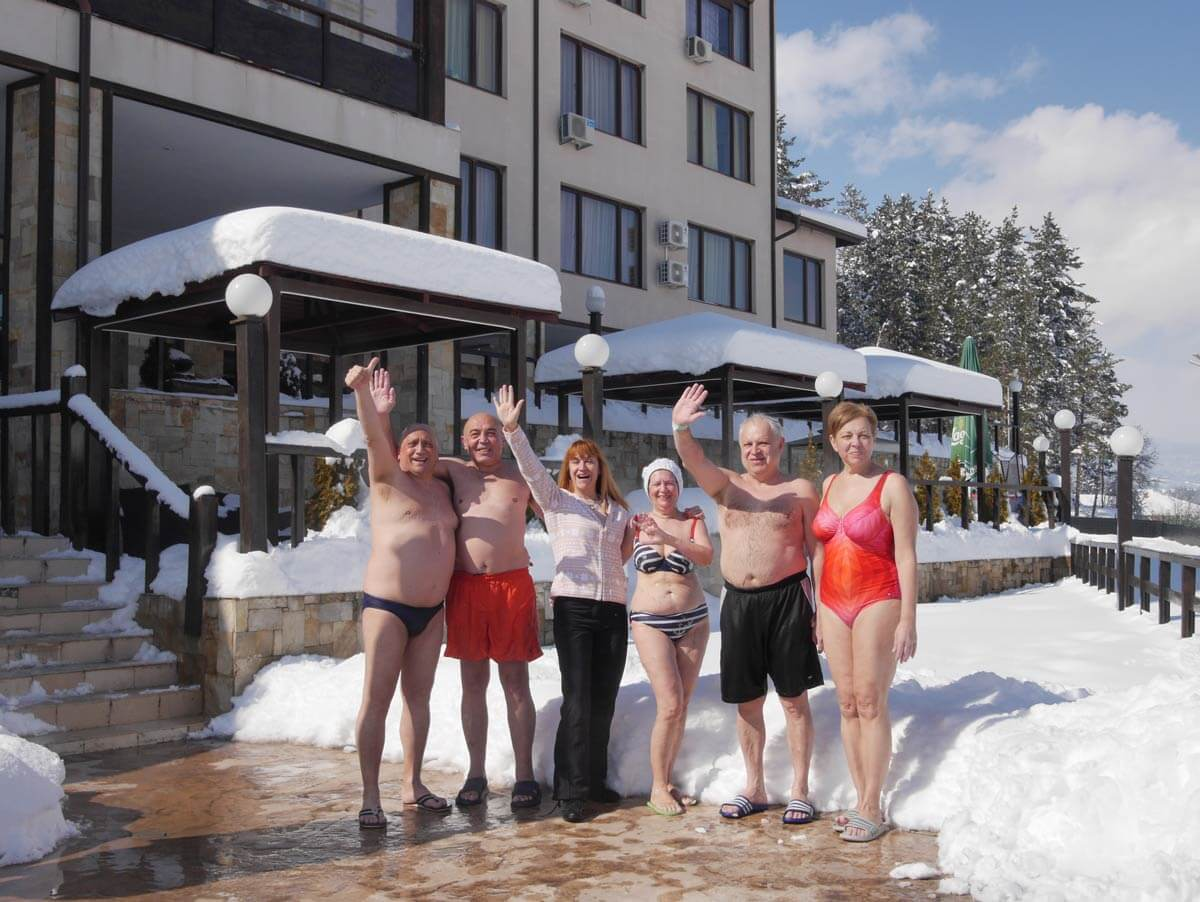 Photo of happy people during the winter in a medical spa hotel in Banya village, Bulgaria