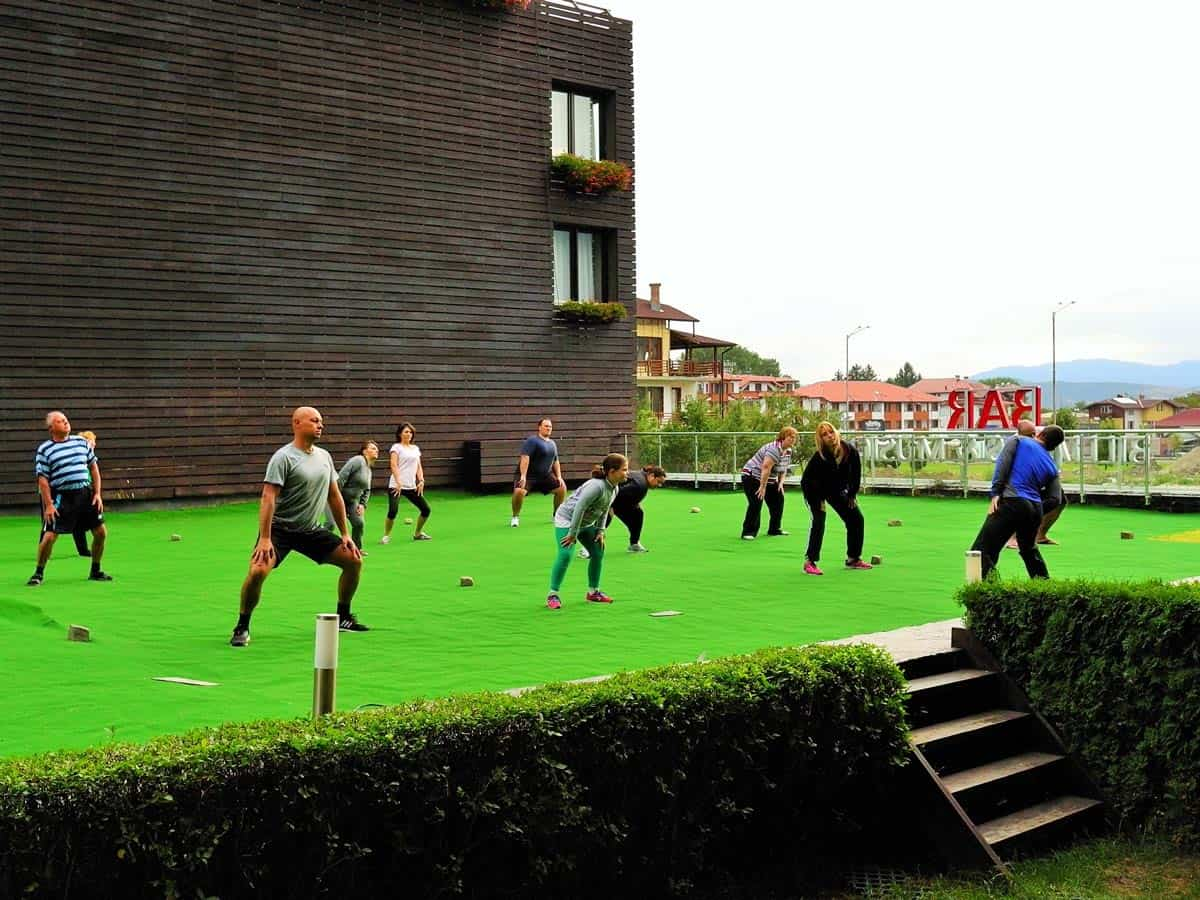 Group of people doing outdoor exercises during a yoga retreat in Bulgaria